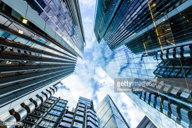 low angle view of glass skyscrapers in the city of london financial district, england, uk - cityscape stock pictures, royalty-free photos & images