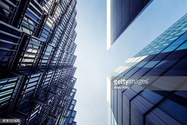 low angle view of glass skyscrapers, london, england, uk - skyscraper stock pictures, royalty-free photos & images