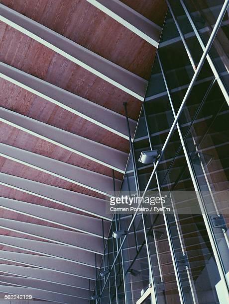 Low Angle View Of Glass Window Against Ceiling Of Building