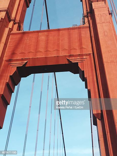 Low Angle View Of Golden Gate Bridge Against Blue Sky