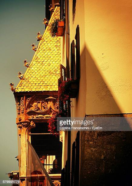 Low Angle View Of Golden Roof Against Sky