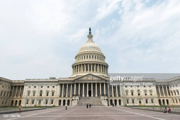 low angle view of government building against cloudy sky - cetkauskas stock pictures, royalty-free photos & images