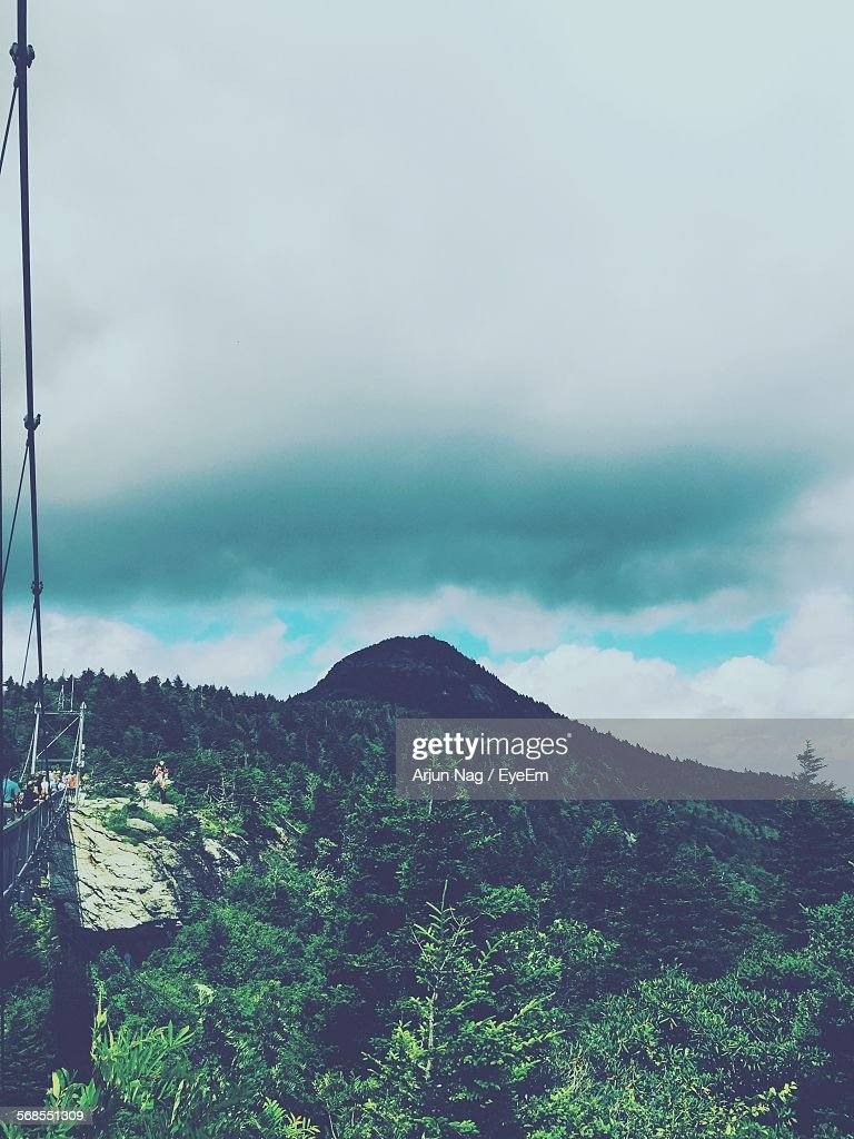 Low Angle View Of Grandfather Mountain By Bridge Against Sky : Stock Photo