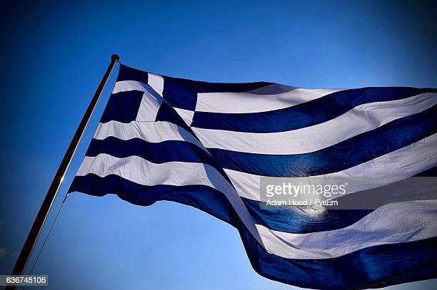 Low Angle View Of Greek Flag Against Clear Sky
