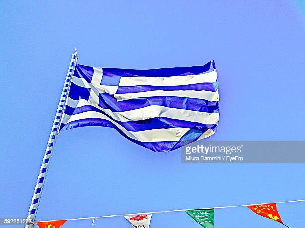 Low Angle View Of Greek Flag Waving Against Clear Blue Sky