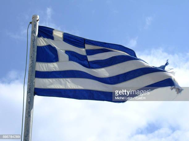 Low Angle View Of Greek Flag Waving Against Sky