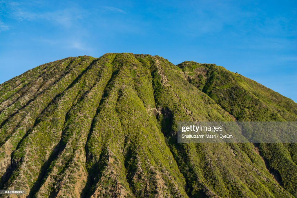 Low Angle View Of Green Mountain Against Sky : Stock Photo