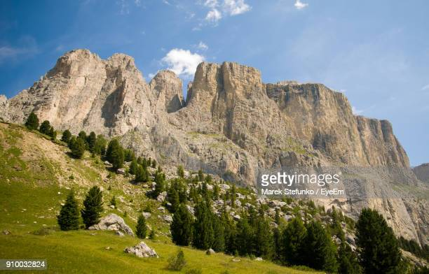 low angle view of green mountains against sky - marek stefunko stockfoto's en -beelden