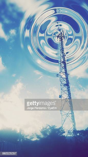 Low Angle View Of Grid Tower Against Rippled Sky