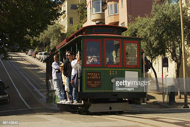"""""""low angle view of group of people in a cable car, san francisco, california, usa"""" - cable car stock pictures, royalty-free photos & images"""