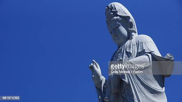 low angle view of guanyin bodhisattva statue at nan hai pu tuo temple - guanyin bodhisattva stock pictures, royalty-free photos & images