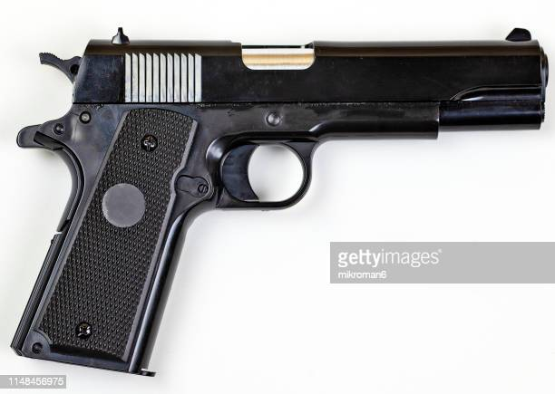 low angle view of gun over white background - pistolet photos et images de collection