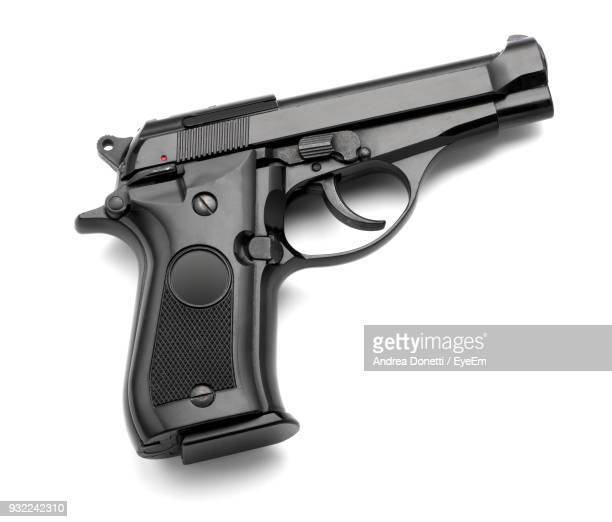 low angle view of gun over white background - 銃 ストックフォトと画像