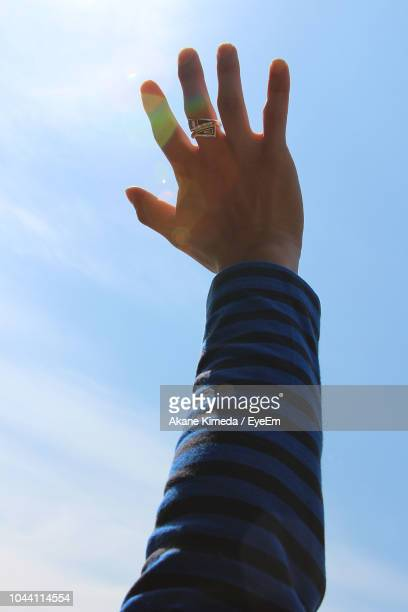 low angle view of hand against sky - doigt humain photos et images de collection