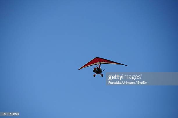 Low Angle View Of Hang Glider Against Clear Blue Sky