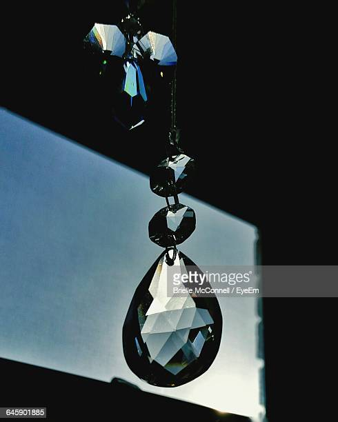 low angle view of hanging light against clear sky - mcconnell stock pictures, royalty-free photos & images