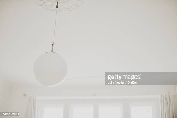 low angle view of hanging light - pendant light stock pictures, royalty-free photos & images