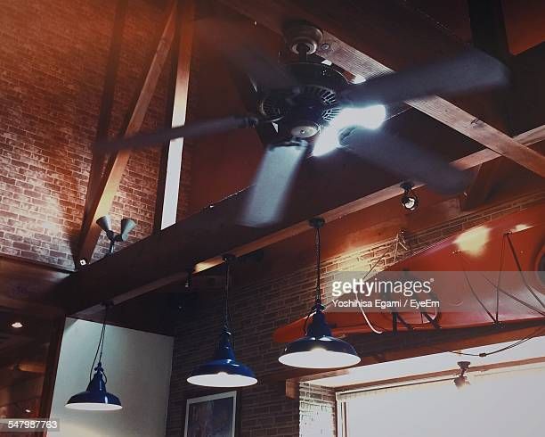 Low Angle View Of Hanging Lights And Fan