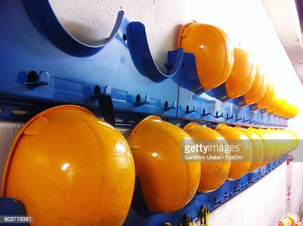 low angle view of hardhat on wall - hard hat stock pictures, royalty-free photos & images