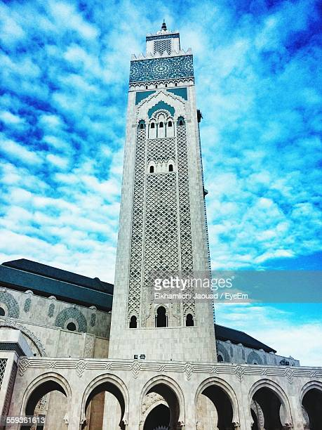 Low Angle View Of Hassan Ii Mosque Against Blue Sky
