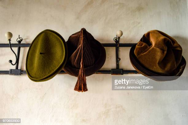 low angle view of hats hanging on wall - zuzana janekova stock pictures, royalty-free photos & images