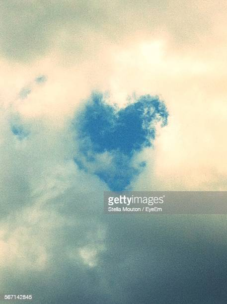 Low Angle View Of Heart Shape In Cloudy Sky