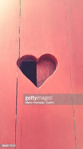 Low Angle View Of Heart Shape On Red Wooden Wall