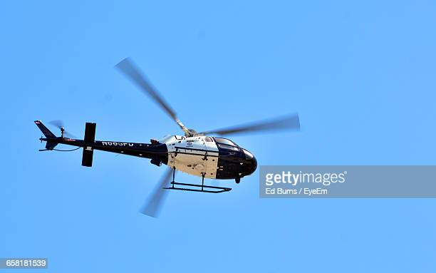 Low Angle View Of Helicopter Against Clear Blue Sky