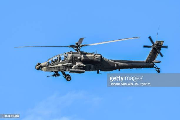 low angle view of helicopter flying against sky - helicopter photos stock pictures, royalty-free photos & images
