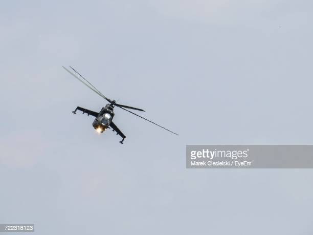 low angle view of helicopter flying in sky - military drones stock photos and pictures