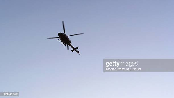 Low Angle View Of Helicopter In Clear Sky