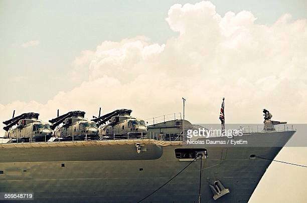 low angle view of helicopters on aircraft carrier - warship stock pictures, royalty-free photos & images