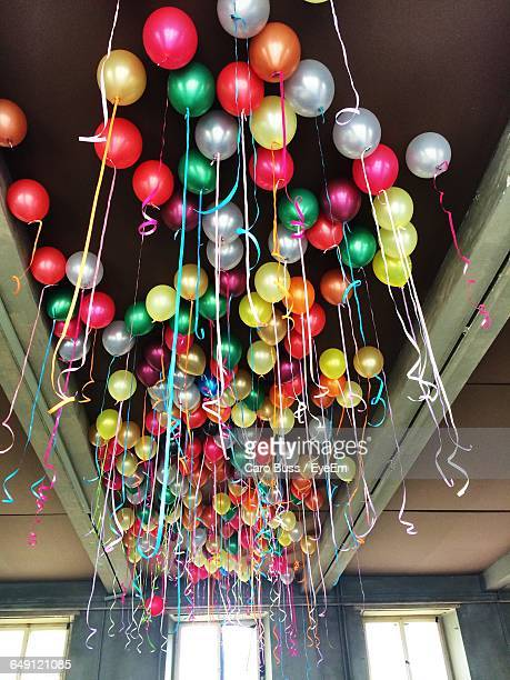 Low Angle View Of Helium Balloons On Ceiling