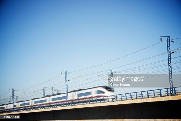 low angle view of high speed train against clear sky - high speed train stock pictures, royalty-free photos & images