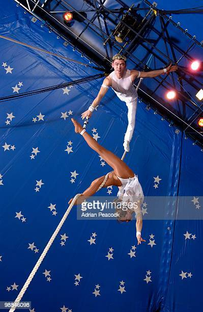 Low angle view of high wire circus performers