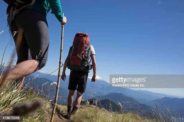 low angle view of hikers on mountain trail - pucon fotografías e imágenes de stock