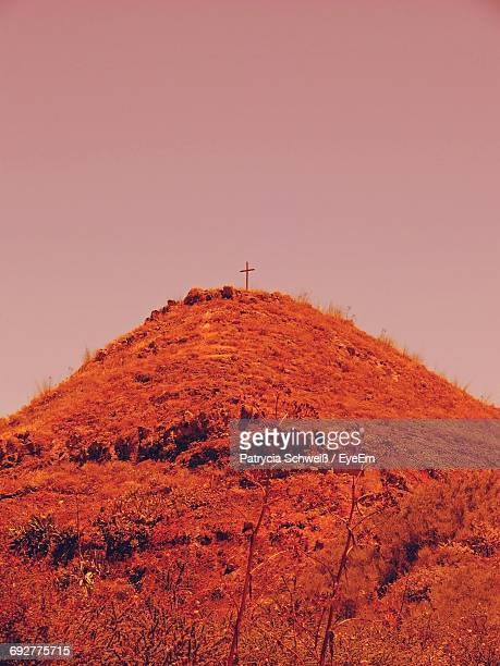 Low Angle View Of Hill With A Cross On Top