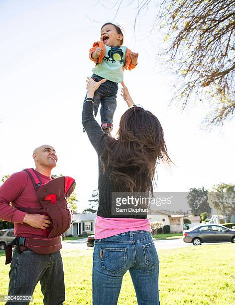 Low angle view of Hispanic family playing in park