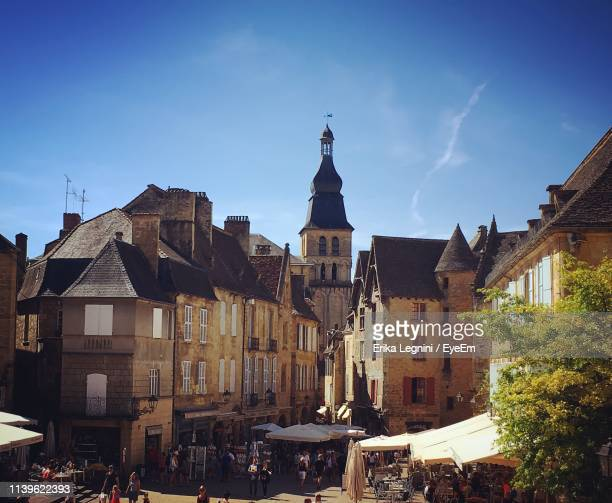 low angle view of historic buildings against blue sky - sarlat stock photos and pictures