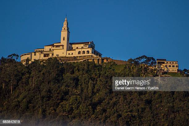 Low Angle View Of Historic Church On Monserrate Against Clear Blue Sky