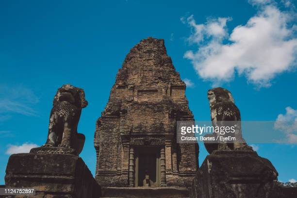 low angle view of historic temple against sky - bortes stock-fotos und bilder