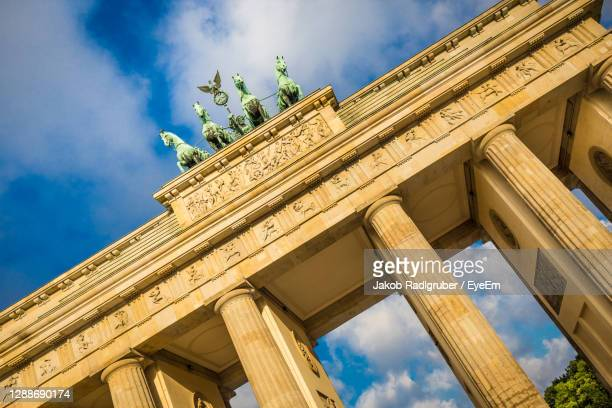 low angle view of historical building against blue sky - capital cities stock pictures, royalty-free photos & images