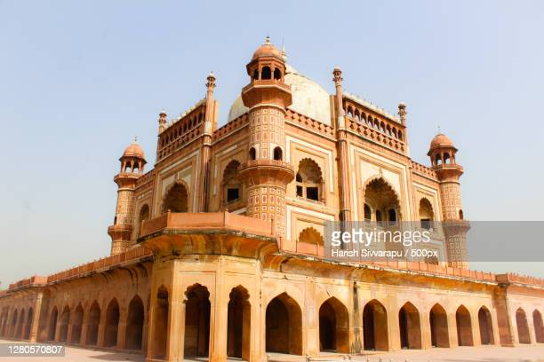 low angle view of historical building against clear sky,new delhi,delhi,india - arch stock pictures, royalty-free photos & images