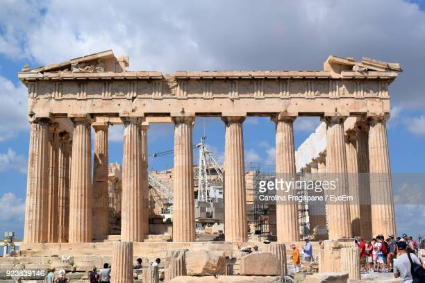 low angle view of historical building against cloudy sky - carolina fragapane stock pictures, royalty-free photos & images