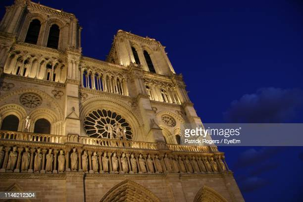 low angle view of historical building against sky at night - faith rogers stock pictures, royalty-free photos & images