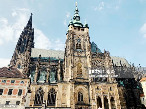 low angle view of historical building against sky - st vitus's cathedral stock pictures, royalty-free photos & images
