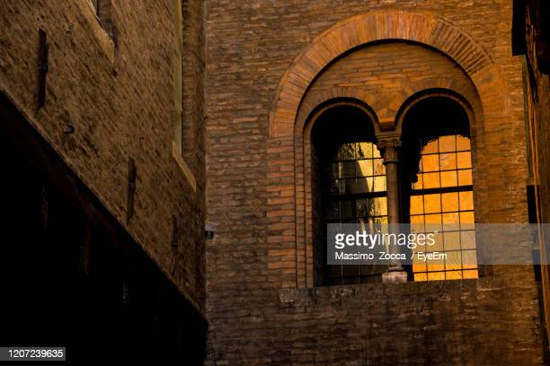 low angle view of historical building - golden hour stock pictures, royalty-free photos & images