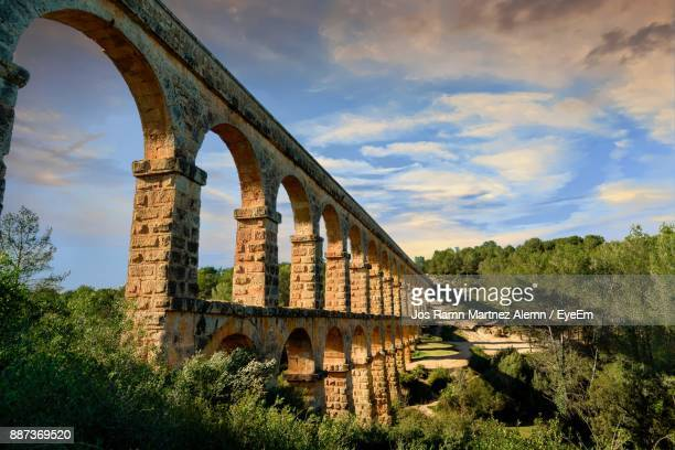 low angle view of historical built structure against cloudy sky - tarragona stock photos and pictures