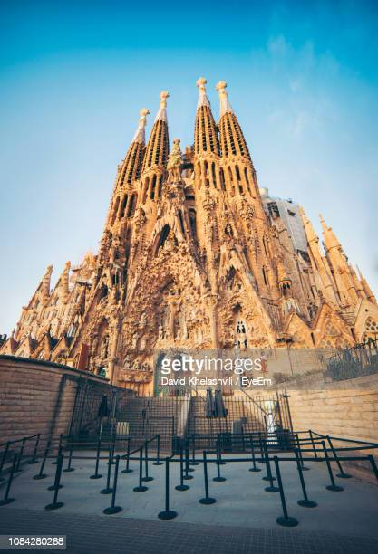 low angle view of historical church against sky - sagrada familia stock pictures, royalty-free photos & images