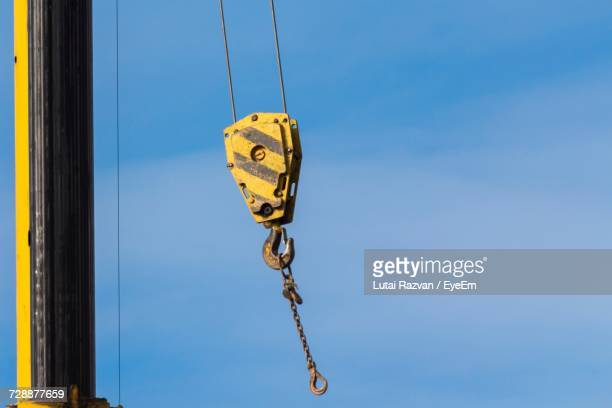 low angle view of hook hanging against sky - lutai razvan stock pictures, royalty-free photos & images